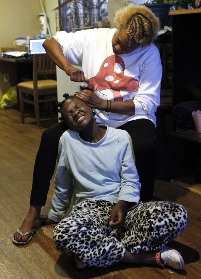 Paula Wooten styles 11-year-old R'reanna Wooten'­s hair before school in their Dallas Housing Authority apartment on May 18.