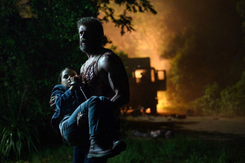 "This image released by Twentieth Century Fox shows Dafne Keen, left, and Hugh Jackman in a scene from ""Logan."""