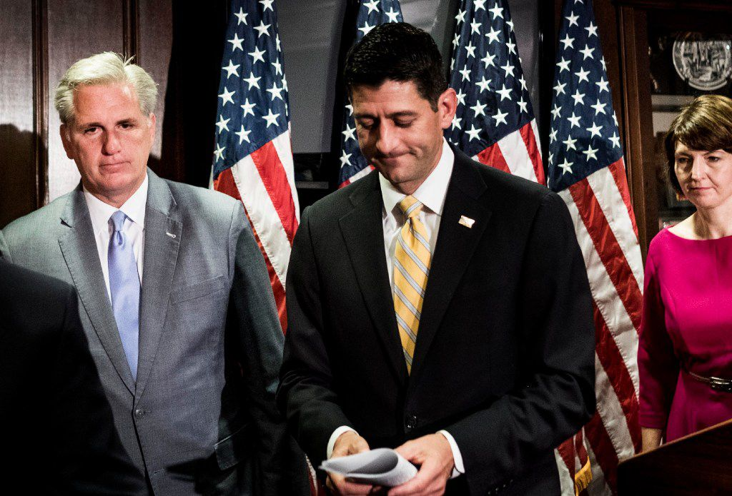 Speaker of the House Paul Ryan (center) and House Majority Leader Kevin McCarthy talk to the press. The two attended a private Republican gathering in June 2016. At the meeting, McCarthy suggested then-candidate Donald Trump was being paid by Russian President Vladimir Putin.