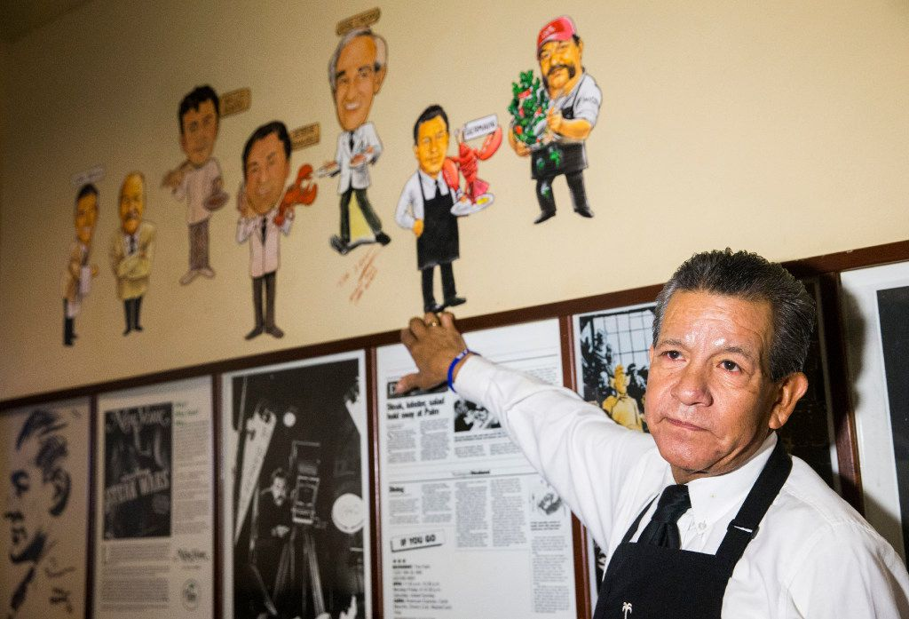 German Calzada, who has worked at the Palm Restaurant for 33 years, shows of his caricature on Tuesday, June 20, 2017 in downtown Dallas