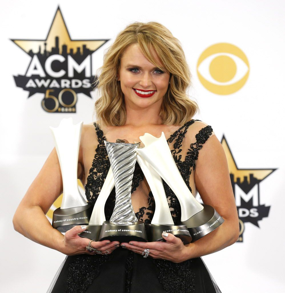 Miranda Lambert poses for a photo with her awards during the 2015 Academy of Country Music Awards Sunday, April 19, 2015 at AT&T Stadium in Arlington, Texas. (Ashley Landis/The Dallas Morning News)