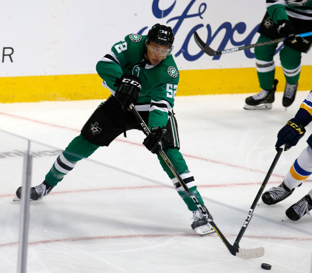 Dallas Stars left wing Jason Robertson (52) fights for the puck against the St. Louis Blues during the first period of their hockey game at American Airlines Center in Dallas on Sept. 18, 2018.  (Nathan Hunsinger/The Dallas Morning News)