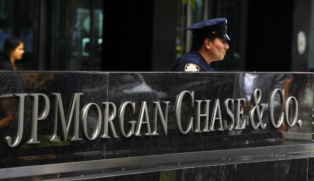 This file photo taken on July 13, 2012 shows a New York City Police officer  at the entrance to the JP Morgan Chase World Headquarters on Park Avenue in New York.  (Timothy A. Clary / Getty Images)