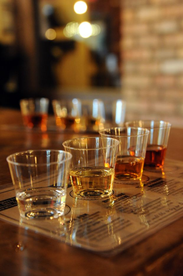 Flights are served for distillery tour guests featuring River rum, River rum Reserve, Texas Straight bourbon, and Bonfire at Witherspoon Distillery in Lewisville, TX on October 24, 2015.