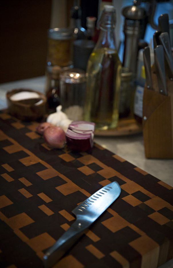 Light reflects off a knife on a cutting board in chef Kent Rathbun's home kitchen Wednesday, November 11, 2015 in Dallas. (G.J. McCarthy/The Dallas Morning News)