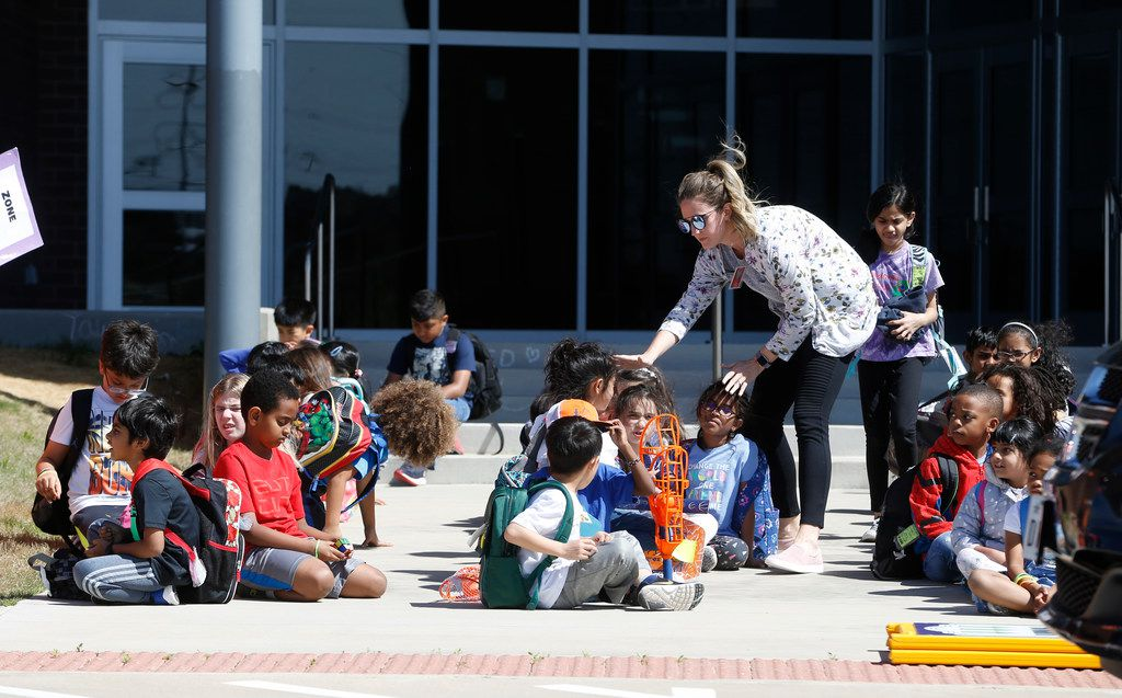 Second-grade teacher Stephanie Shannon helps students line up before being picked up from the recently relocated Richard J. Lee Elementary in Coppell, which affords a window on a startling demographic shift in the Dallas area: Well more than half of the students are from families of Indian heritage, and 79 percent can trace their ethnic origin to South Asia and the Far East, according to district officials.