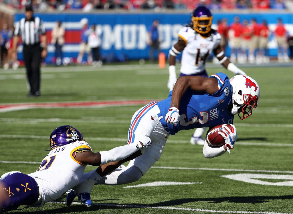 DALLAS, TEXAS - NOVEMBER 09:  James Proche #3 of the Southern Methodist Mustangs is tackled by Ja'Quan McMillian #21 of the East Carolina Pirates in the first half at Gerald J. Ford Stadium on November 09, 2019 in Dallas, Texas. (Photo by Ronald Martinez/Getty Images)