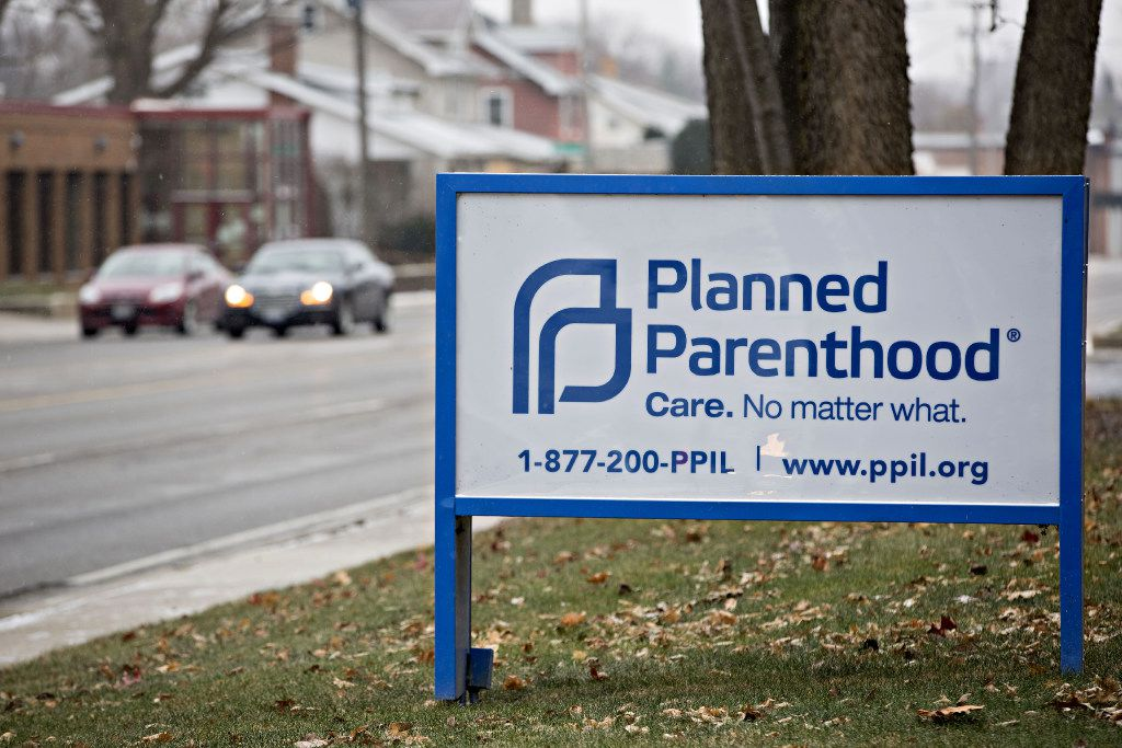 Signage is displayed outside a Planned Parenthood office in Peoria, Illinois, U.S., on Friday, Dec. 16, 2016. Republicans are thinking ahead to regulations Obama might still try to complete before he leaves office, including a pending rule barring states from blocking funds to Planned Parenthood. Photographer: Daniel Acker/Bloomberg News.
