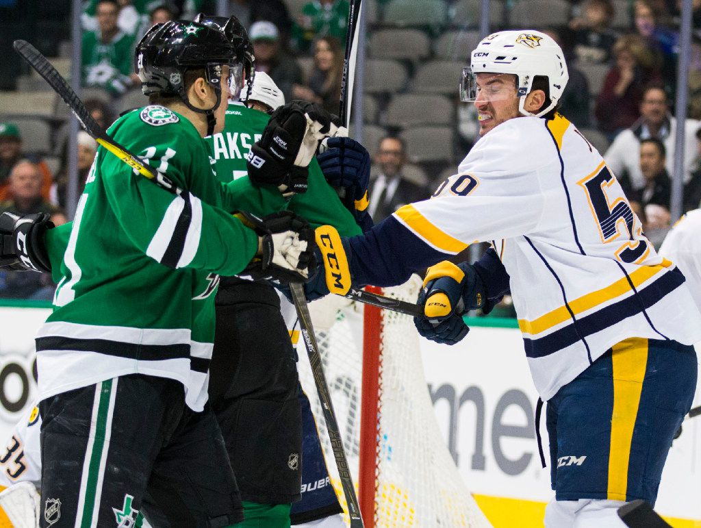 Dallas Stars left wing Antoine Roussel (21) gets hit with a stick by Nashville Predators defenseman Roman Josi (59) during the first period of their game on Thursday, December 8, 2016 at the American Airlines Center in Dallas. (Ashley Landis/The Dallas Morning News)