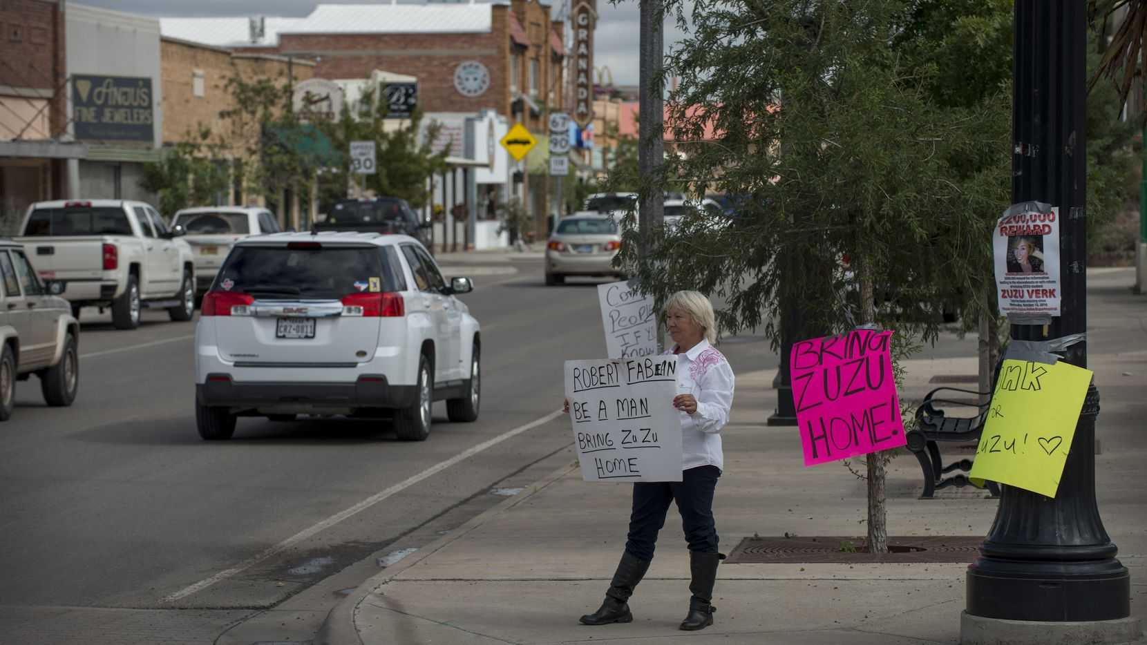 "Alpine resident Glenda Westerman holds a sign pleading for Zuzu Verk's boyfriend to help authorities investigate her disappearance."" (Robert W. Hart/Special Contributor)"