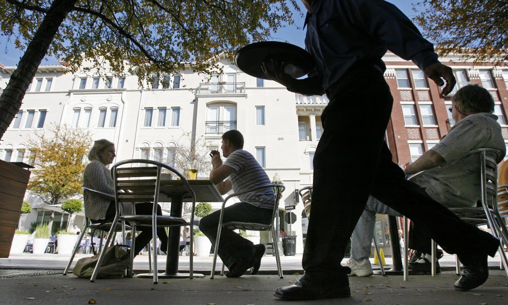 Residents of Uptown and the West Village enjoy a sun-splashed afternoon on the patio of Mi Cocina near the Magnolia Theater in Uptown on Dec. 7, 2007. (DMN File photo).