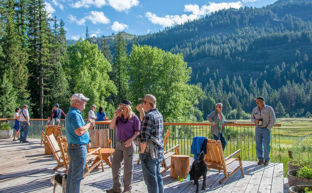 Guests congregate on the deck at the Minam River Lodge.