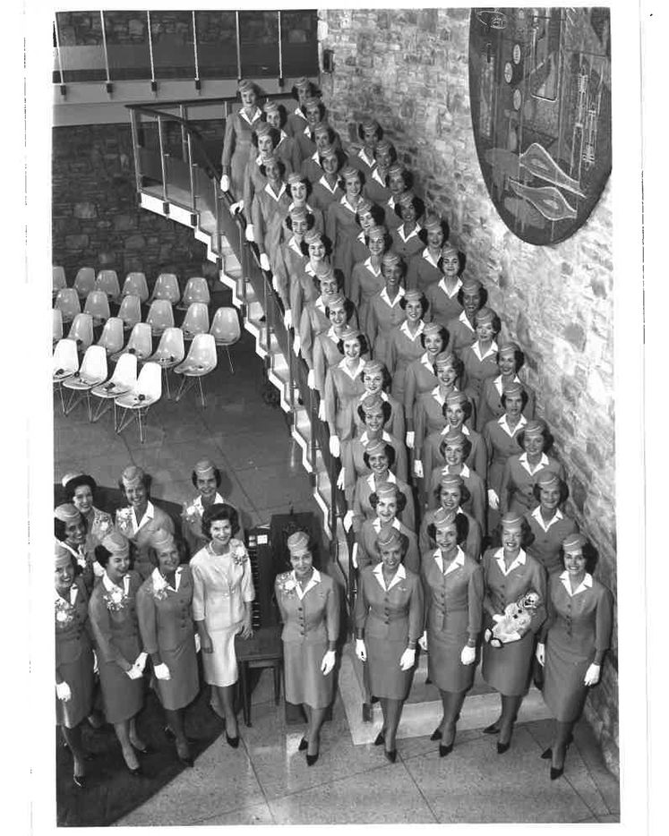 American Airlines flight attendants graduating in 1963 posed for a photo on the staircase at the Stewardess College.