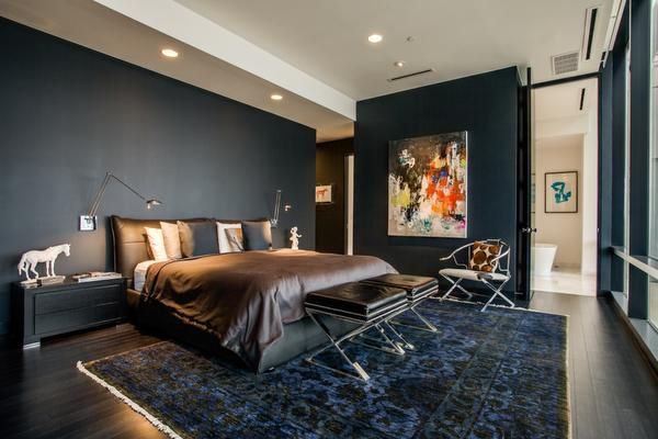 The walls of the second-floor master bedroom and study are black to create an ambience of solitude.