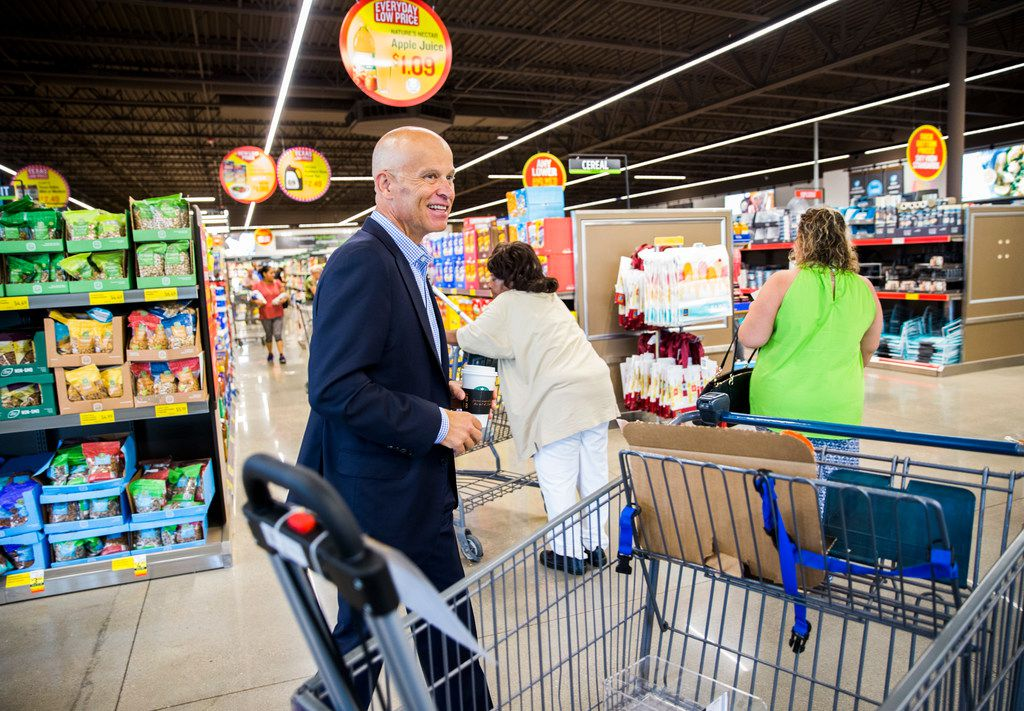 Scott Huska, vice president of the Denton Division of Aldi, Inc., greets shoppers in a newly renovated Aldi grocery store on Gaston Avenue on Sept. 20, 2018 in Dallas.