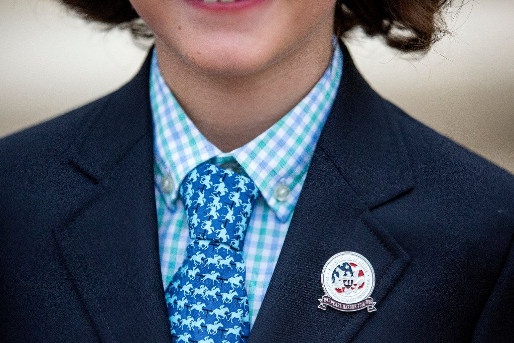 Jack Smith, 8, wears a pin commemorating the 75th Anniversary of Pearl Harbor before a remembrance at the George Bush Presidential Library on Wednesday, Dec. 7, 2016, in College Station, Texas. (Smiley N. Pool/The Dallas Morning News)