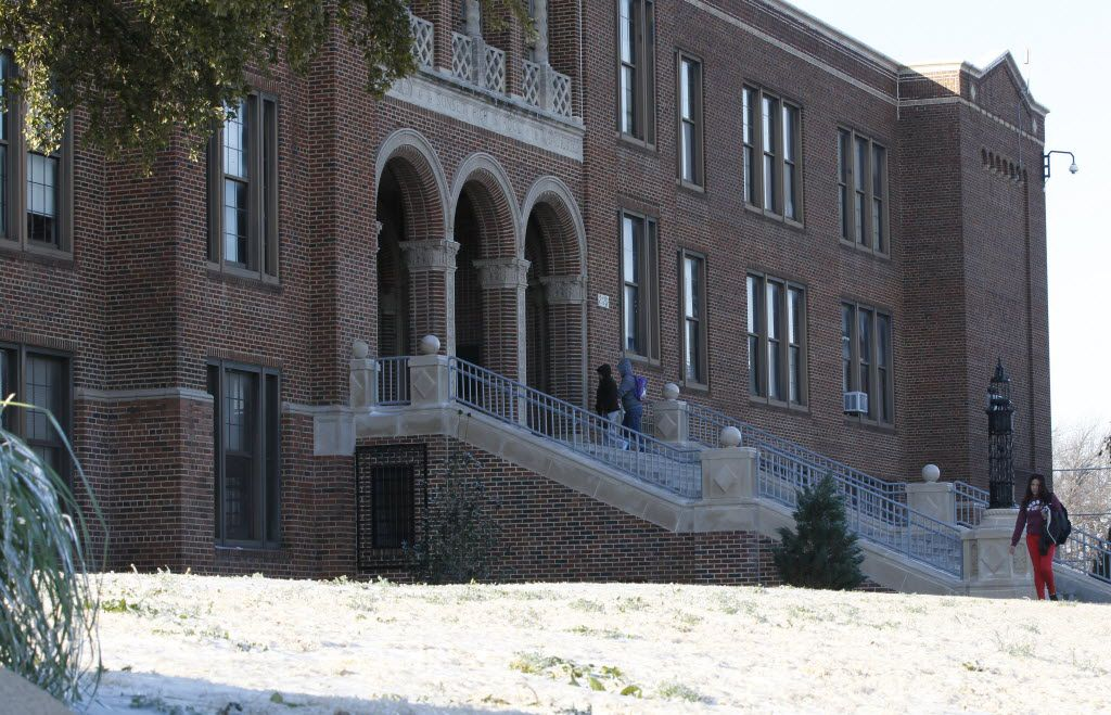 Students walked to class at Sunset High School in the cold weather on Dec. 10, 2013 .