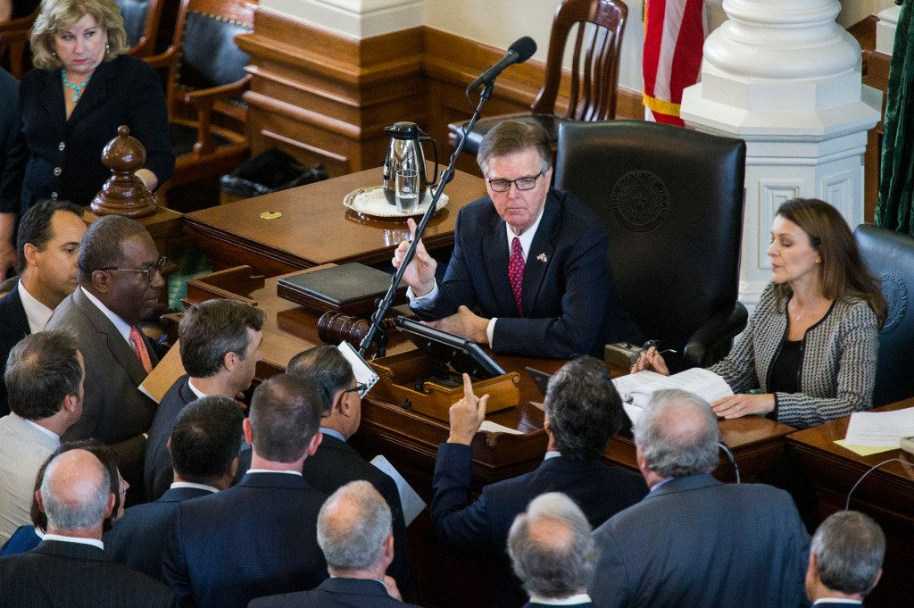Senators argue a point of order with Lt. Gov. Dan Patrick and parliamentarian Karina Casari Davis during the first day of a legislative special session last July at the Capitol in Austin.