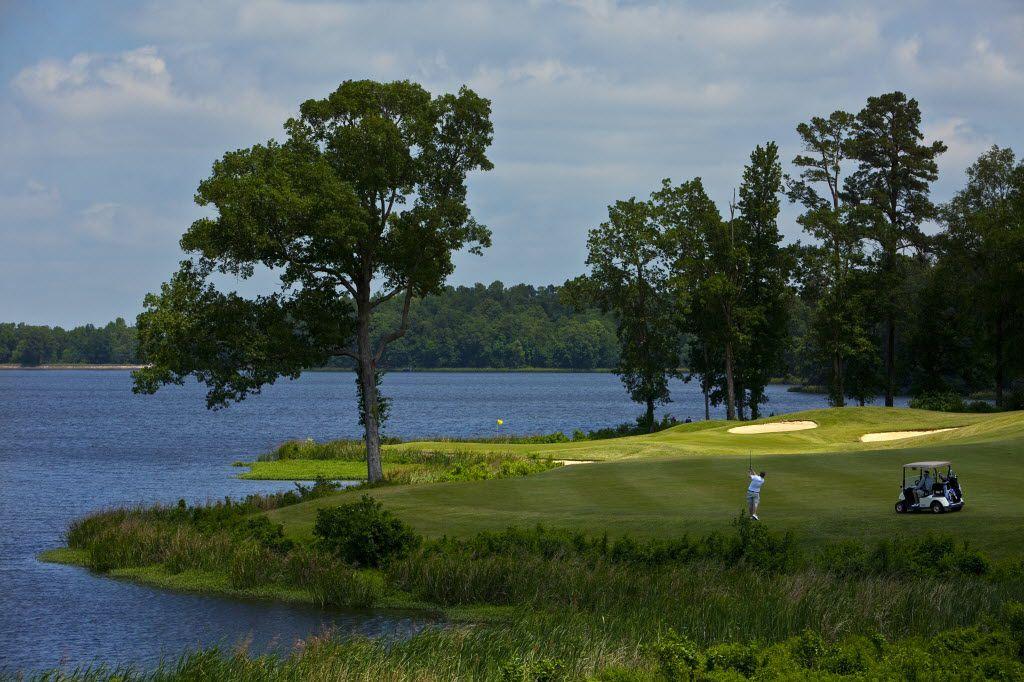 Lake Bringle runs alongside the par-5 No. 16 as a golfer makes his approach shot to the green(seen on the back left)  at Texarkana Golf Ranch 7401 Scott Wright Road Texarkana, Tx 75503 , Friday, May 13, 2011.  (Tom Fox/The Dallas Morning News) 06122011xTexasGolf2011