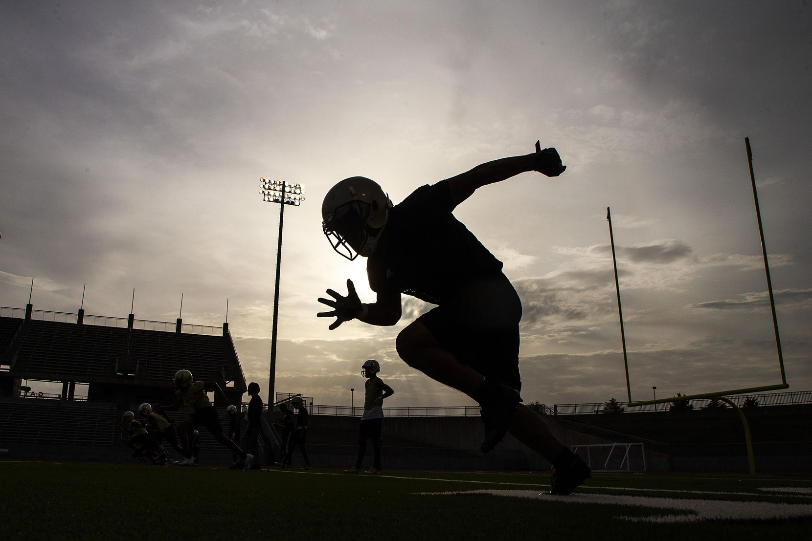 South Oak Cliff players run a drill during their season-opening football practice at John Kincaide Stadium on Monday, Aug. 13, in Dallas.