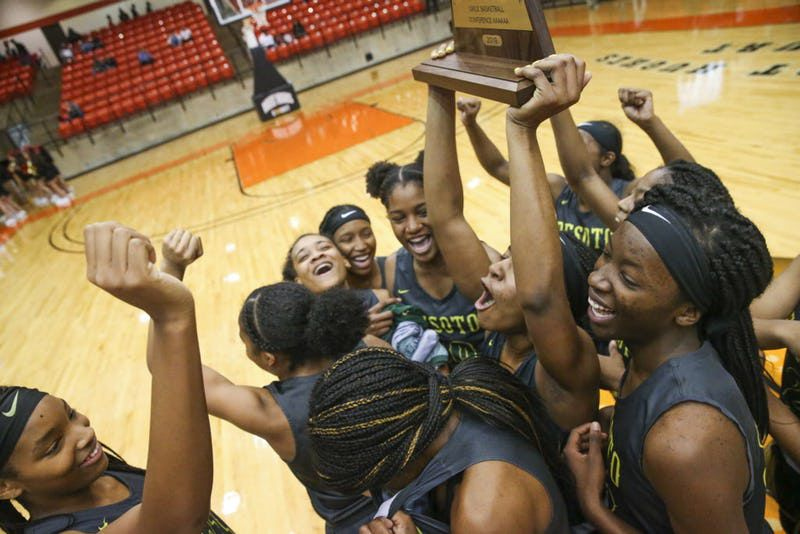 DeSoto guard Ash'a Thompson (25) hoists the trophy after defeating South Grand Prairie 51-34 in the 6A Region I final women basketball game at Wilkerson-Greines Activity Center in Fort Worth, Texas on Saturday, Feb. 23, 2019. (Shaban Athuman/The Dallas Morning News)