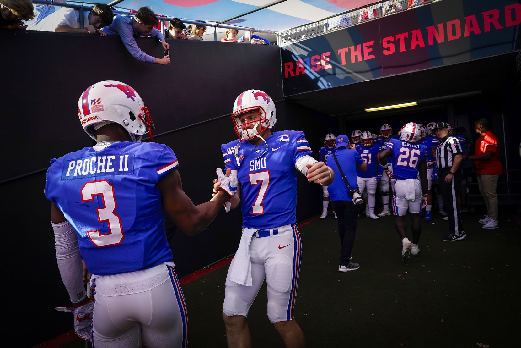 SMU quarterback Shane Buechele (7) prepares to take the field with SMU wide receiver James Proche (3) before an NCAA football game against Tulane at Ford Stadium on Saturday, Nov. 30, 2019, in Dallas.