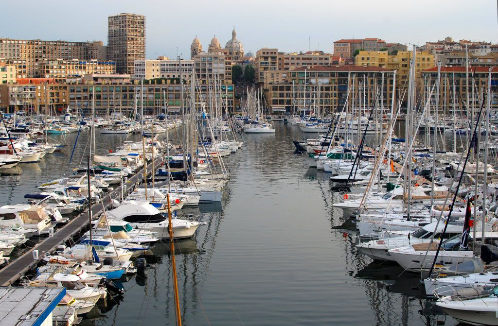 Fishing boats, sailboats and pleasure craft are docked year-round in the Old Port (Vieux Port) of Marseille, France.