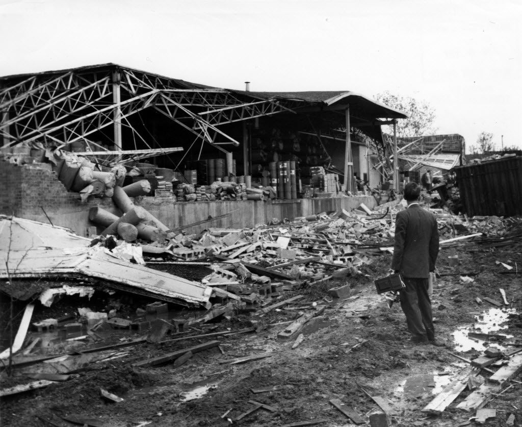 A man gets a closer look at a warehouse destroyed by the 1957 tornado in Dallas.