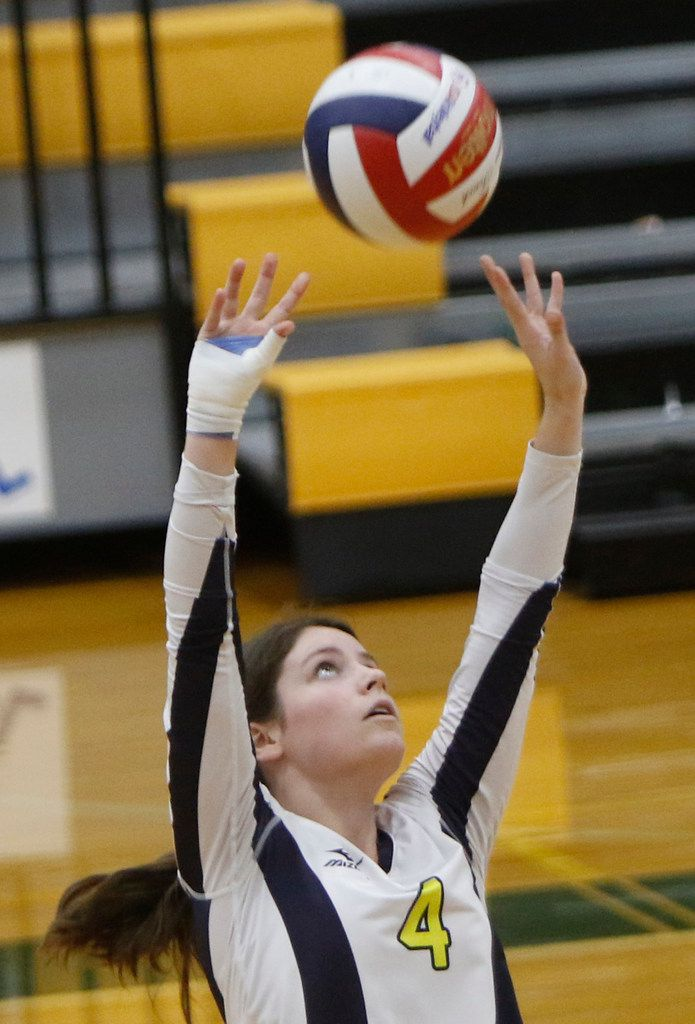 Highland Park setter Jeanne Tulimieri (4) seta a teammate during the first game of their match against Carrollton Newman Smith. The two teams played their District 11-5A volleyball match at Carrollton Newman Smith High School in Carrollton on October 8, 2019. (Steve Hamm/ Special Contributor)