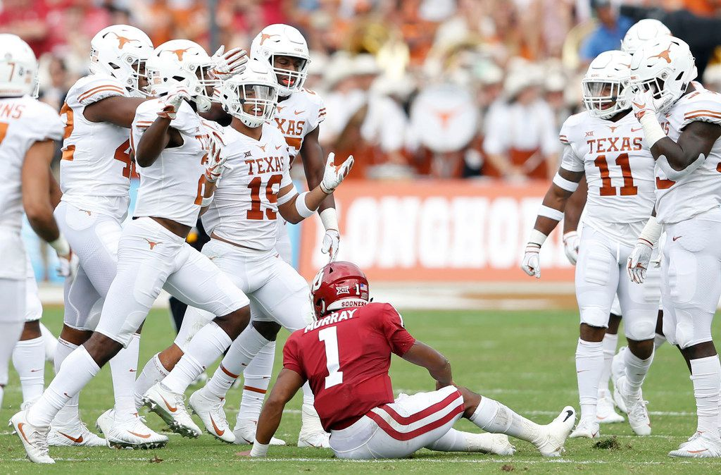 Texas defensive back Brandon Jones (19) celebrates with teammates after intercepting a pass from Oklahoma quarterback Kyler Murray (1) during the first half at the Cotton Bowl in Dallas on Saturday, Oct. 6, 2018. Texas won, 48-45. (Vernon Bryant/Dallas Morning News/TNS)