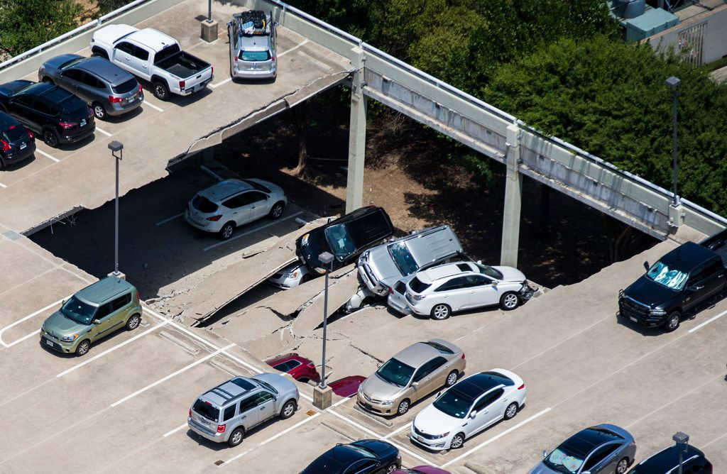 Emergency crews respond to a collapsed parking garage in Irving, Texas, on Tuesday, July 31, 2018. Authorities say a preliminary search indicated no one was hurt.