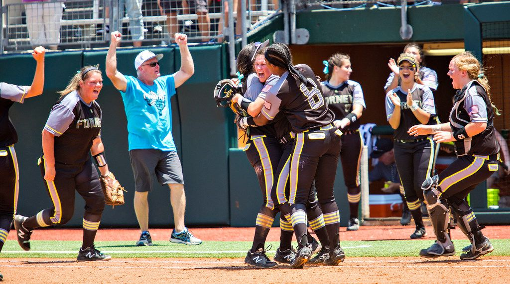 Forney pitcher Savanna DesRochers (center) celebrates with her team after beating Mont Belvieu Barbers Hill in a Class 5A state semifinal last season.  (Thao Nguyen/Special Contributor)