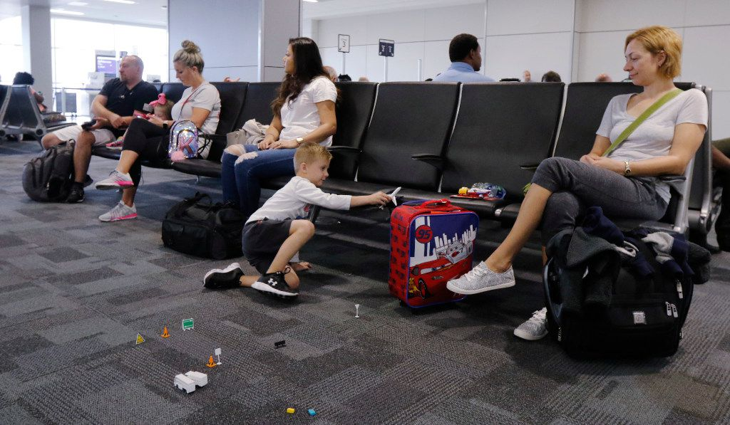 Lana Tokuev of Dallas, right, watches her son Daniel, 4, play with airplanes in Terminal E at Dallas Fort Worth International Airport on Wednesday, August 23, 2017. Today marks the second completed terminal in DFW's $2.7 billion Terminal Renewal and Improvement Program to renovate three of it's original terminal buildings. (David Woo/The Dallas Morning News)