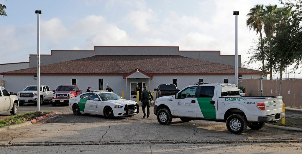 """FILE - In this June 23, 2018 file photo, a U.S. Border Patrol Agent walks between vehicles outside the Central Processing Center in McAllen, Texas. U.S. border agents have temporarily closed their primary facility for processing migrants in South Texas one day after authorities say a 16-year-old died after being diagnosed with the flu at the facility. In a statement released late Tuesday, May 21, 2019, U.S. Customs and Border Protection said it would stop detaining migrants at the processing center in McAllen, Texas. CBP says """"a large number"""" of people in custody were found Tuesday to have high fevers.  (AP Photo/David J. Phillip, File)"""