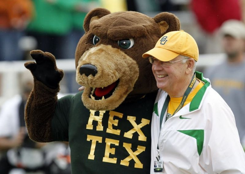 Ken Starr, then Baylor's president, with the school's mascot before a football game between the Bears and the University of Texas in Waco on Dec. 3, 2011.