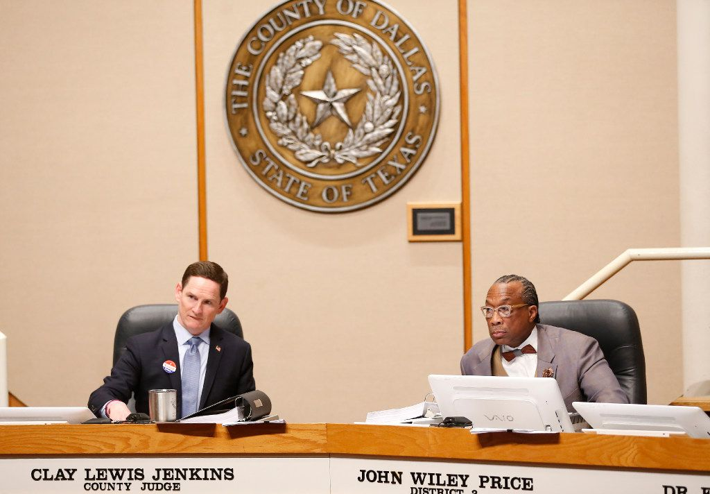 County Judge Clay Jenkins (left) and District 3 Commissioner John Wiley Price listened during a Commissioners Court meeting.