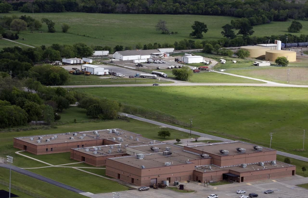 A housing project is proposed on the empty field between Whitewright High School (foreground) and El Dorado Chemical Co. in Whitewright, Texas. El Dorado Chemical is licensed to handle ammonium nitrate, the same chemical that caused the explosion at the West Fertilizer Co. three years ago.