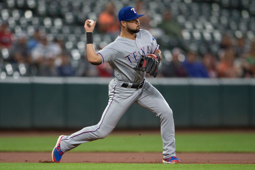 Texas Rangers third baseman Isiah Kiner-Falefa throws to second base for the force out of Baltimore Orioles' Trey Mancini during the first inning of a baseball game, Thursday, Sept. 5, 2019, in Baltimore. (AP Photo/Tommy Gilligan)