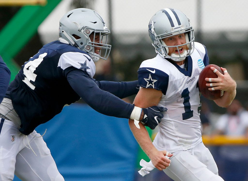 Cowboys wide receiver Cole Beasley (right) is tackled by defensive end Dorance Armstrong (left) during an afternoon practice at training camp in Oxnard, Calif., on Saturday, July 28, 2018. (Jae S. Lee/The Dallas Morning News)