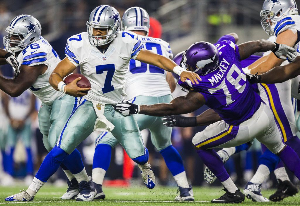 Dallas Cowboys quarterback Jameill Showers (7) is sacked by Minnesota Vikings guard Stephen Goodin (78) during the fourth quarter of their game on Saturday, August 29, 2015 in Arlington, Texas.  The Cowboys lost 28-14. (Ashley Landis/The Dallas Morning News)