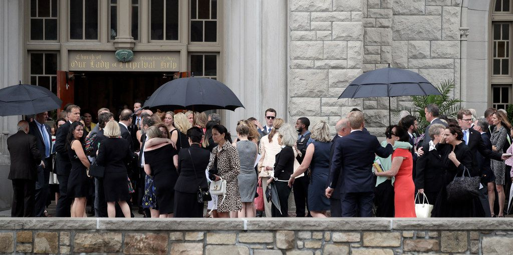 Mourners for Kate Spade gather outside Our Lady of Perpetual Help Catholic Church in Kansas City, Mo., Thursday, June 21, 2018. (AP Photo/Orlin Wagner)