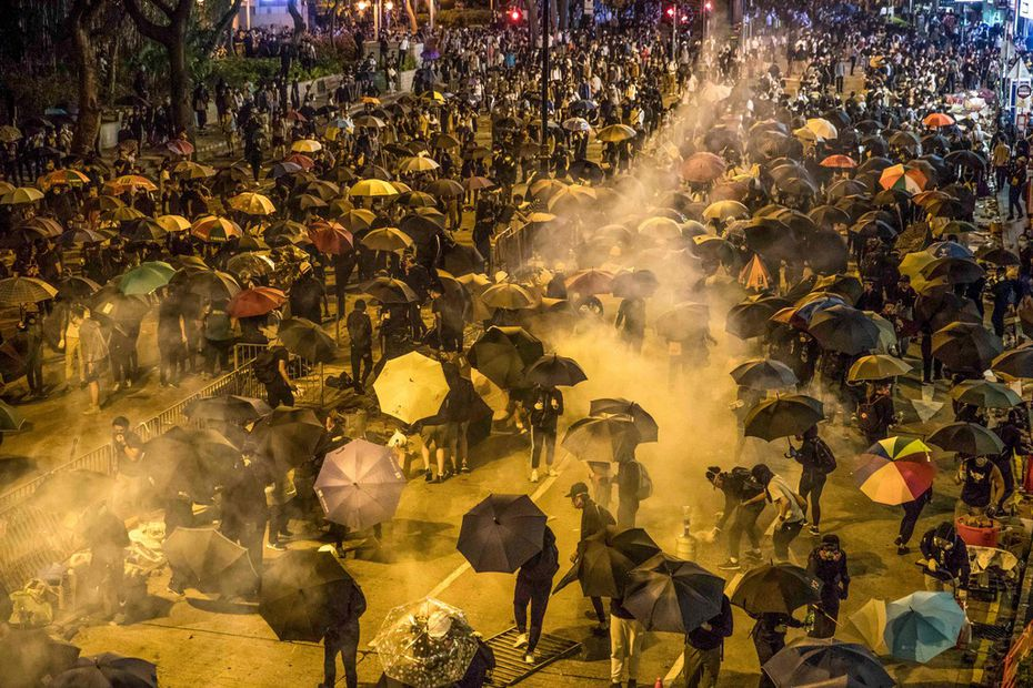 Policed fired tear gas as protesters attempted to march toward Hong Kong Polytechnic University on Nov. 18, 2019. Dozens of protesters escaped a two-day police siege at the campus by shimmying down a rope from a bridge to awaiting motorbikes.