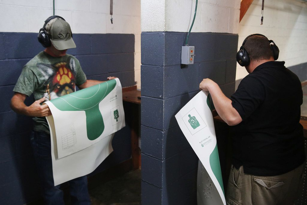William Carter (left) and Glen Gallup Jr., both of Santa Fe, Texas, take down their targets after a license to carry class hosted by Mark Giordonello at Big Kountry Shooting and Archery gun range in Alvin, Texas, Saturday May 19, 2018. Carter took the class with his wife Angela Carter. On Friday morning, 10 people were killed and 13 were injured after a shooting at Santa Fe High School. William Carter's stepdaughter Victoria Garcia, 16, was in the school at the time of the shooting and ran outside during history class. Dimitrios Pagourtzis was booked into the Galveston County Jail on capital murder charges. The class was scheduled before the shooting occurred.