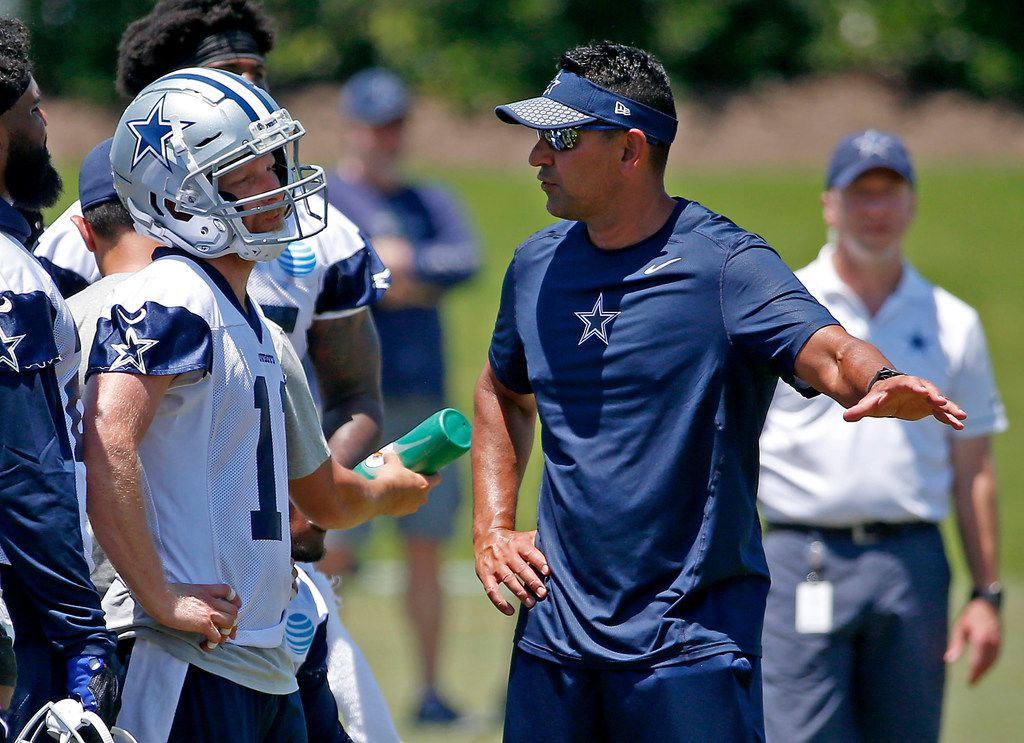 Dallas Cowboys wide receiver coach Sanjay Lal, right, talks with wide receiver Cole Beasley during OTA practice at the Star in Frisco, Texas, Wednesday, May 30, 2018. (Jae S. Lee/The Dallas Morning News)