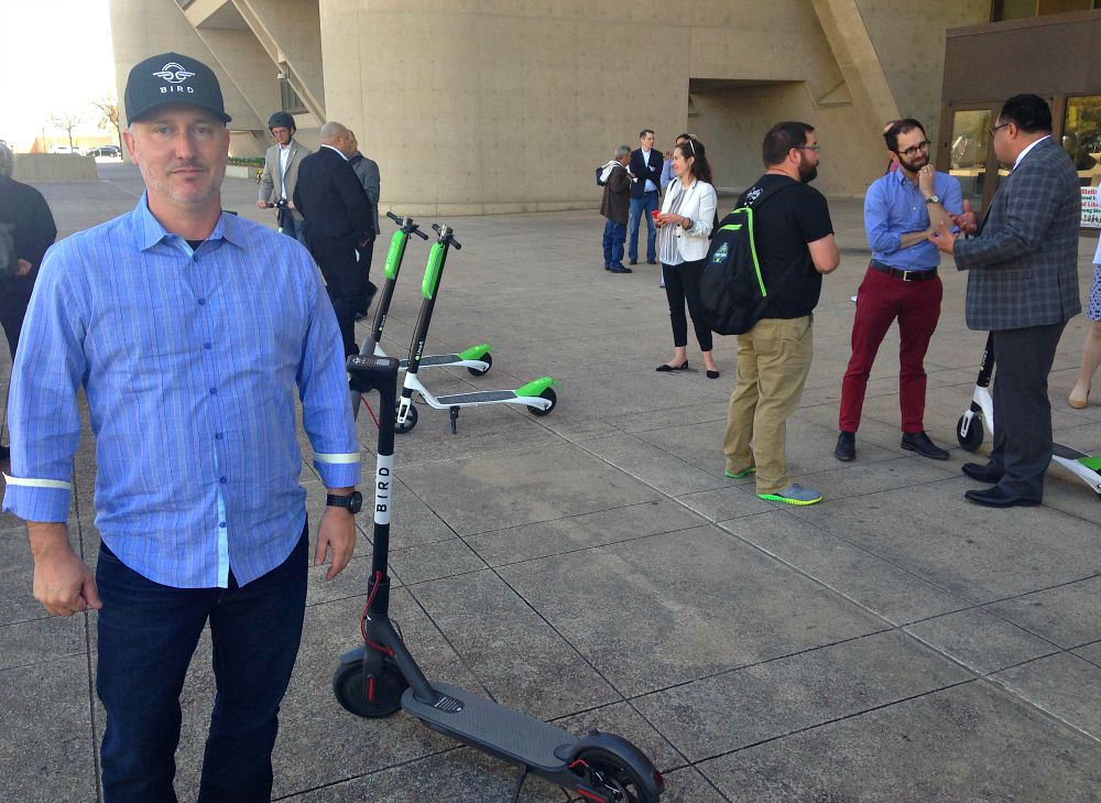 Matt Shaw, Bird's director of government relations, offered free rides on his company's electric scooters in front of Dallas City Hall on Wednesday.