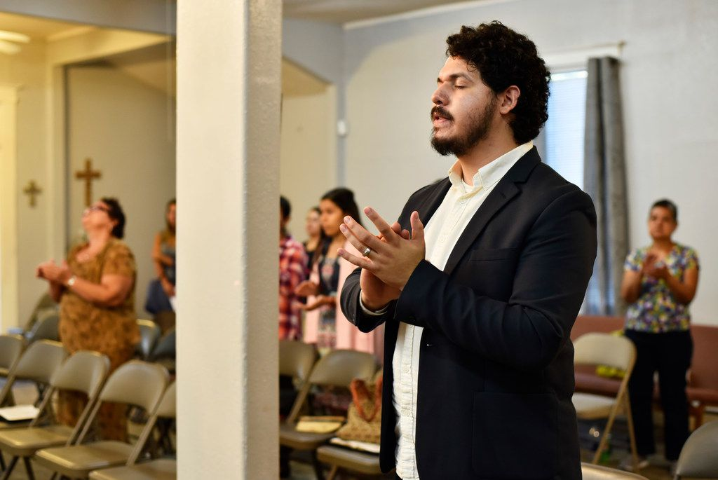 Pastor Juan Ríos, 25, claps his hands while praising during a church service at Iglesia Mi Casa de Oración in Dallas, Sept. 24, 2017. Ríos is originally of the Mexican state of Coahuila .Ben Torres/Special Contributor