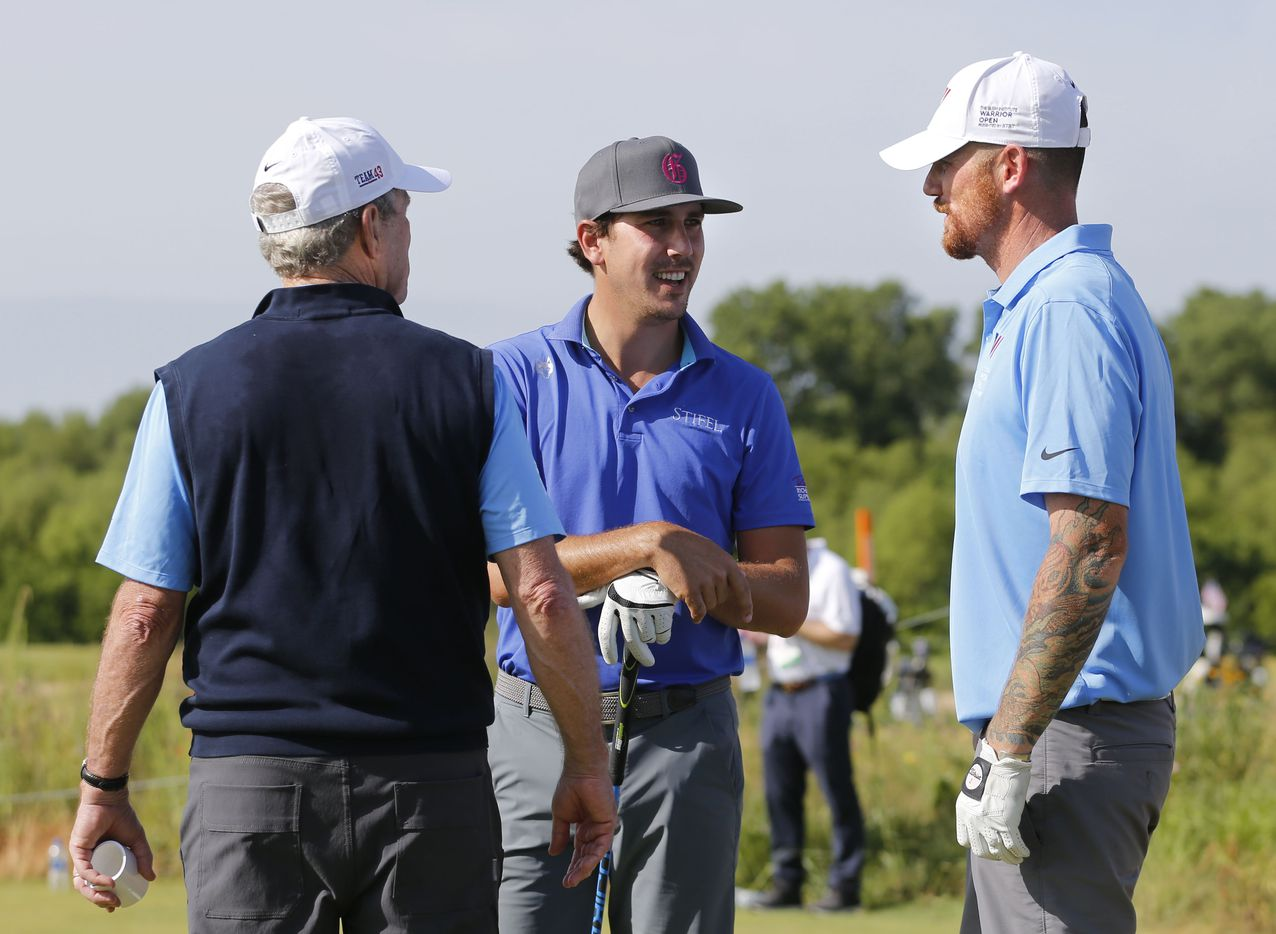 George W. Bush, 43rd President of the United States, talks with Kelly Kraft (center) and Staff Sgt. Andrew Bachelder at the first tee.