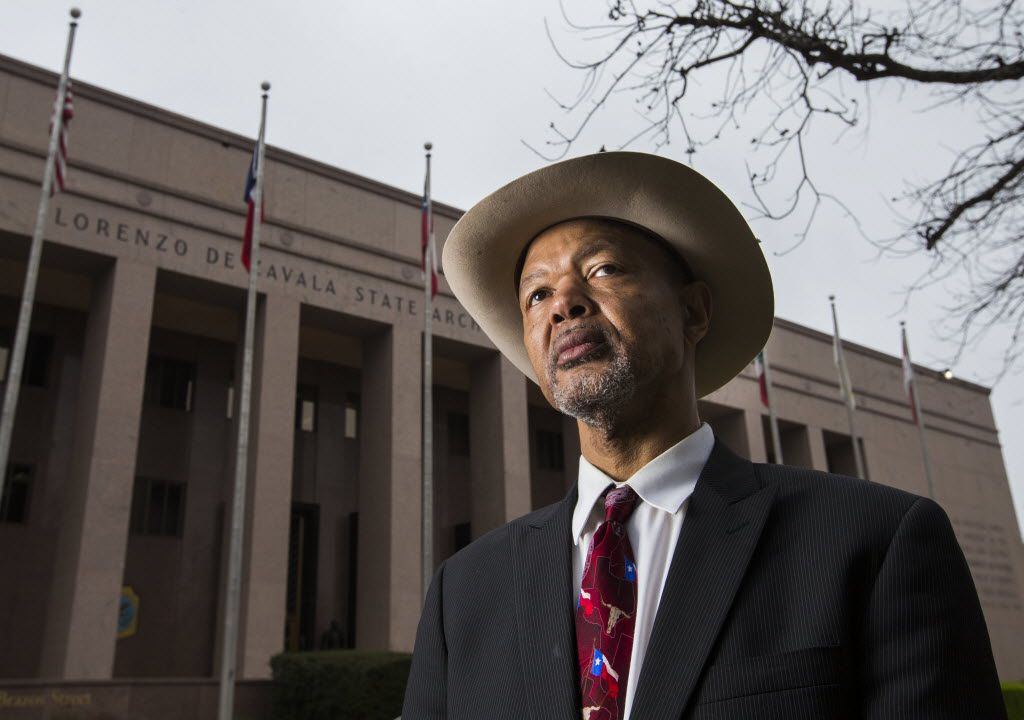 Texas NAACP President Gary Bledsoe poses outside the Lorenzo DeZavala State Archives and Library building, which displays all six flags that have flown over Texas, on Tuesday, March 17 in Austin, Texas.  Bledsoe is opposing a campaign by the Sons of Confederate Veterans to place an emblem with the Confederate battle flag on novelty license plates.  He suggests using the Confederate flag, which shows 13 stars in a circle on a blue background in the top right corner and two red bars with a white bar in the middle, rather than the Confederate battle flag, which has the more recognizable X-shaped pattern, because the battle flag has never flown over the state of Texas. (Ashley Landis/The Dallas Morning News) / mug - mugshot - headshot / 03222015xNEWS 05102015xNEWS