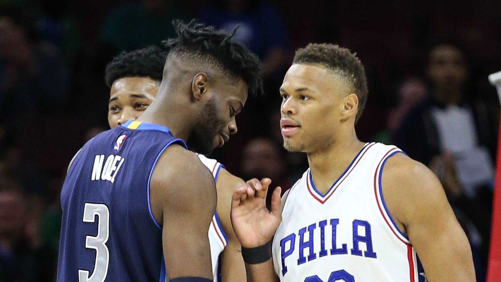 The Philadelphia 76ers' Justin Anderson (23) chats with the Dallas Mavericks' Nerlens Noel (3), who he was recently traded for, during the first quarter at the Wells Fargo Center in Philadelphia on Friday, March 17, 2017. The Sixers won, 116-74. (Steven M. Falk/Philadelphia Inquirer/TNS)