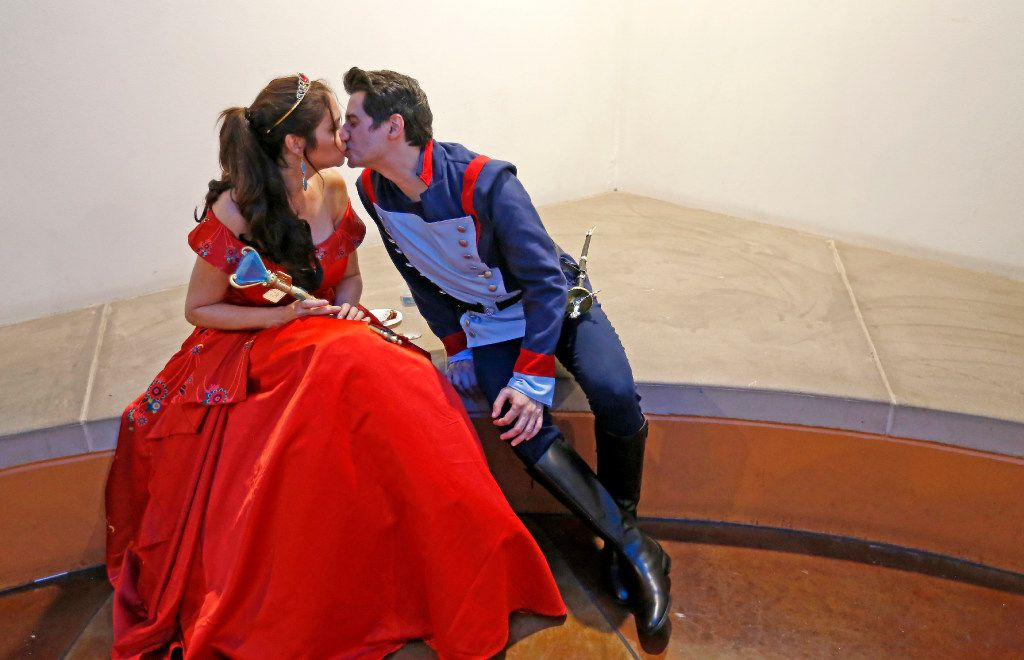 """Elizabeth Sanchez (left), dressed as Princess Elena of Avalor, gets a kiss from her husband Daniel Sanchez, dressed as Lt. Gabriel """"Gabe"""" Nuñez, during Texas Latino Comic Con at Latino Cultural Center in Dallas, Saturday, July 29, 2017. (Jae S. Lee/The Dallas Morning News)"""